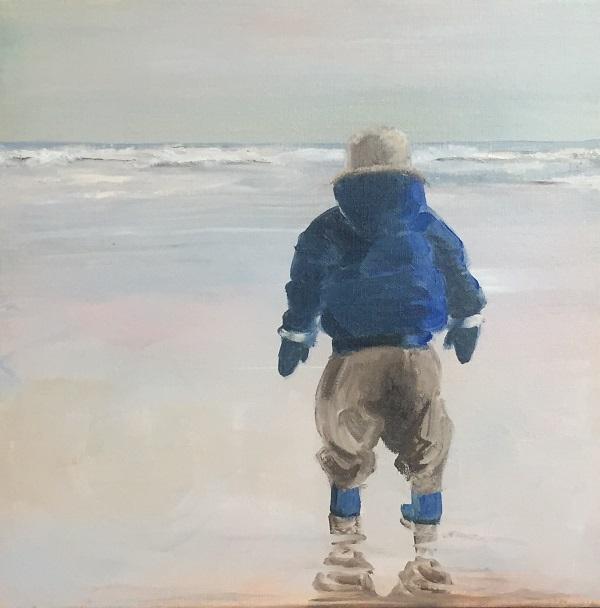 jongen aan zee